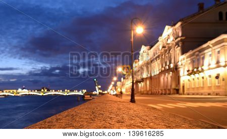 Blurred Palace Embankment of Neva River in St.Petersburg at night Russia.