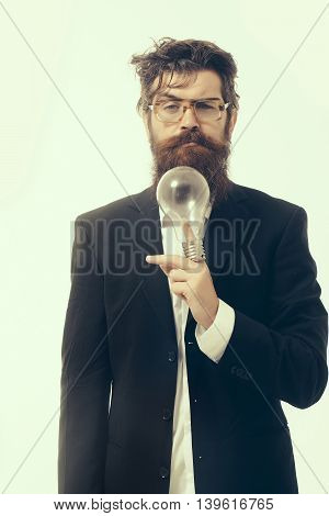 young handsome bearded man scientist or professor in glasses with long beard holding lamp isolated on white background
