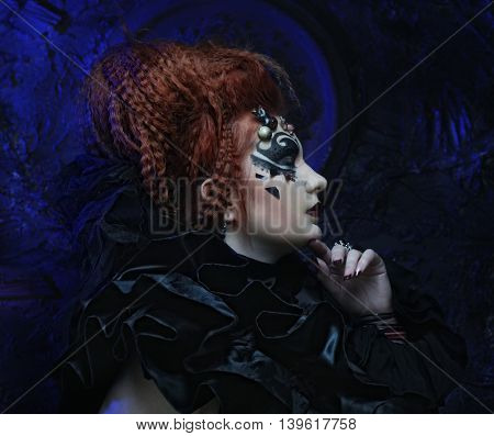 Dark redhair woman. Halloween picture.