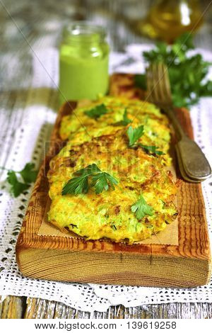 Zucchini Fritters With Garlic And Carrot.
