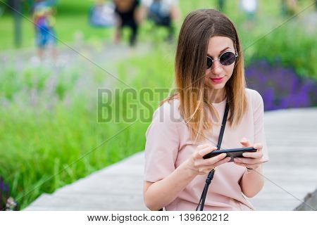 Tourist woman with smartphone on summer holidays.