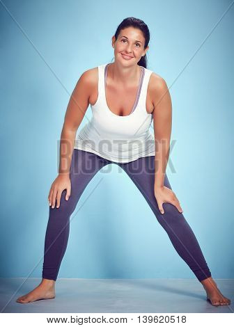 Happy Smiling Young Yoga Woman Stretching Her Feet