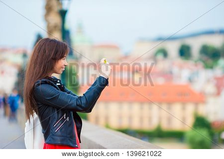 Tourist woman taking travel photos with smartphone on summer holidays.