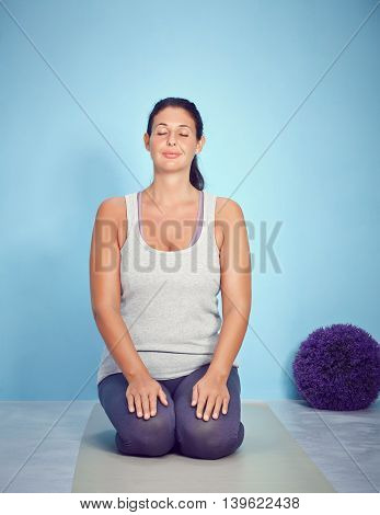 Young Yoga Fitness Woman Meditating And Stretching
