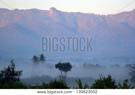 Beautiful morning mist and mountain view background
