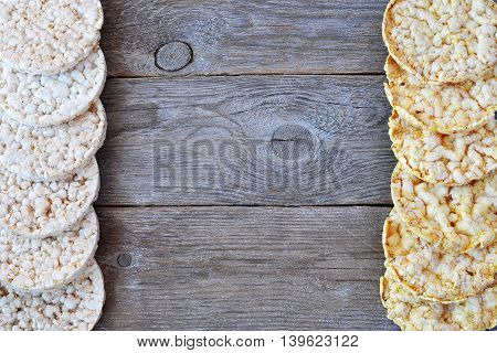 Round rice cakes and corn cakes on wooden table. With space for text backgraund.
