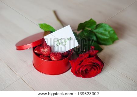 Valentine s day card. Red roses and gift box with gold bow.