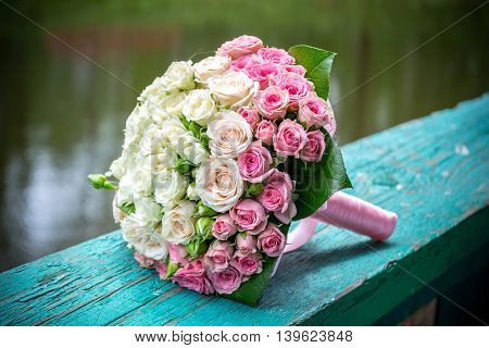 wedding bouquet with pink and white roses