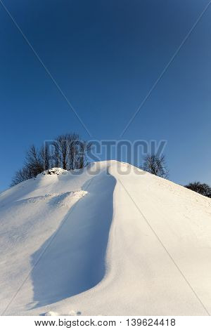 photographed close-up of a snow-covered hill. Grodno. Belarus.
