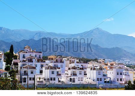 White Spanish dwelling on the base of a mountain in Nerja