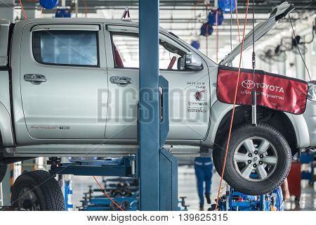 PHUKET THAILAND - JUNE 30 : Car technician repairing car in workshop service station in Phuket on June 30 2016. The official dealer of Toyota who is the top market share for commercial car.