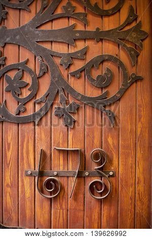 Ornate numbers on an old timber door