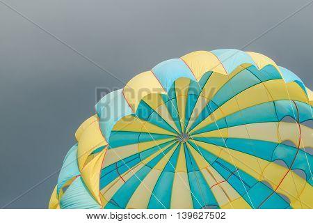 Parasailing, Beach Umbrella On Sky Background