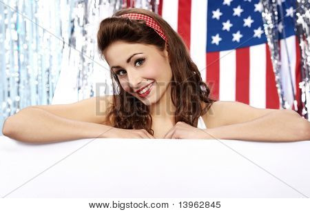 American girl holding blank board. Flag background