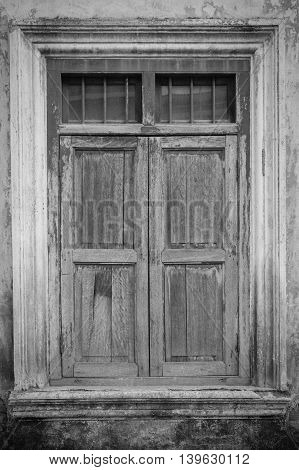 Old window closed in black and white.