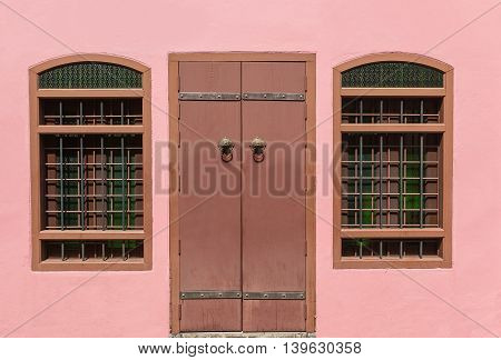 Ancient Chinese style woods doors on prink.