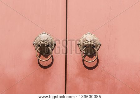 Traditional Chinese Door knocker on rad wall