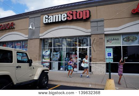 JOLIET, ILLINOIS / UNITED STATES - AUGUST 30, 2015: One buy or sell games at the Game Stop in a Joliet strip mall.
