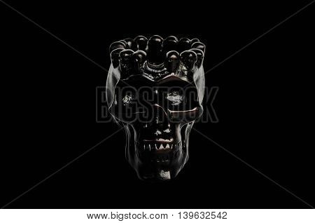 Black skull isolated on a black background.