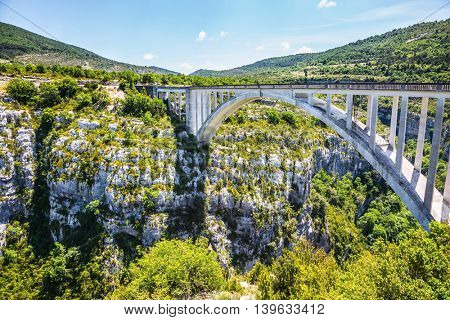 The white bridge over tributary of the river Verdon Artuby. The largest alpine canyon Verdon. Canyon of Verdon, Provence, France