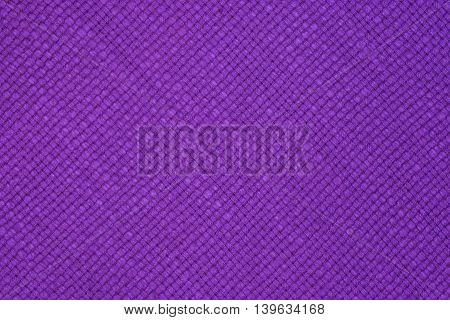 Closeup detail of purple fabric background Closeup detail of purple fabric background