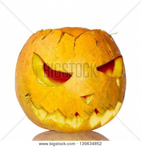 Scary carved pumpkin lantern isolated on white
