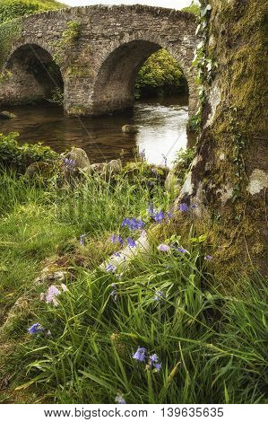 Landscape Image Of Medieval Bridge In River Setting In English Countryside