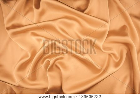 Smooth elegant golden silk can use as wedding background. In Sepia toned. Retro style