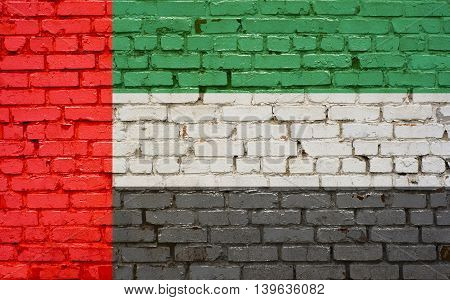 Flag of United Arab Emirates painted on brick wall background tehture
