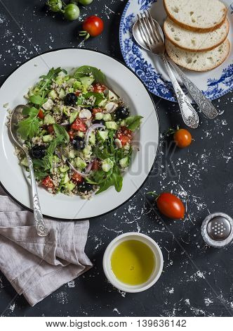 Mediterranean style quinoa and vegetables salad on a dark background. Delicious vegetarian food