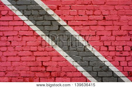 Flag of Trinidad and Tobago painted on brick wall background texture
