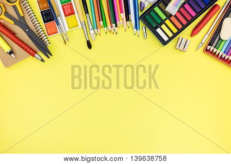 Bright School Supplies For Education On Yellow Background