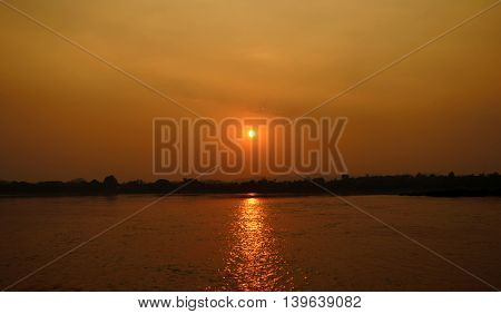 photo of beautiful sunset over the river