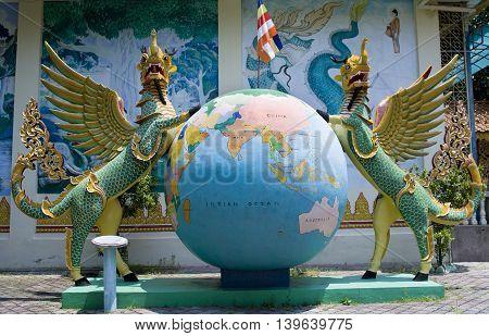 Statue in Dharmikarama burmese temple on island Penang Malaysia