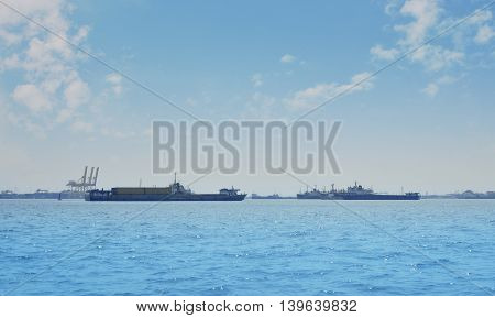 Cargo ship with shipping port over blue sea