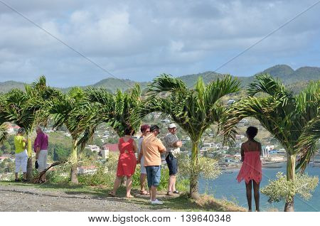 DENNERY ST LUCIA CARIBBEAN 19 January 2015: Tourists looking over small Caribbean Town