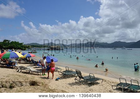 ST LUCIA CARIBBEAN 17 January 2015: Holidaymakers enjoying the beach