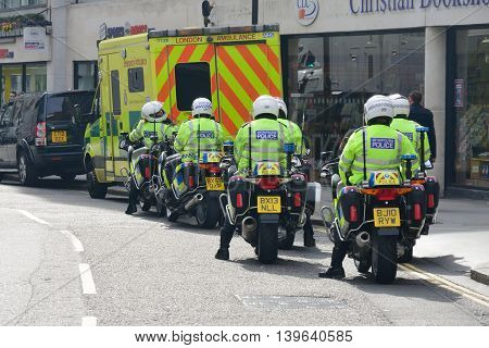 CITY OF LONDON ENGLAND 13 March 2015: Police Motorcyclists from behind