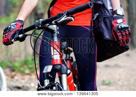 Bikes cycling girl. Girl rides bicycle into park. Girl in cycling . Cycling is good for health. Middle past of bicycle girl.
