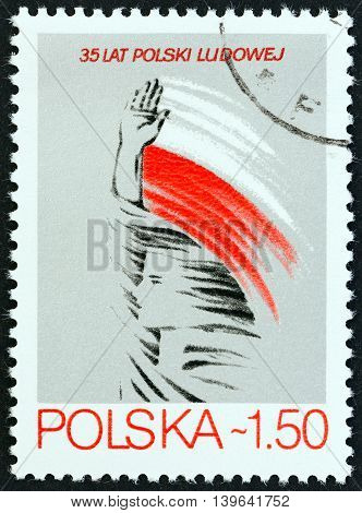 POLAND - CIRCA 1979: A stamp printed in Poland issued for the 35th anniversary of the Polish People Republic shows girl and stylized flag (poster art by Mieczyslaw Wasilewski), circa 1979.