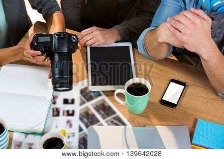 High angle view of business people working at table in creative office