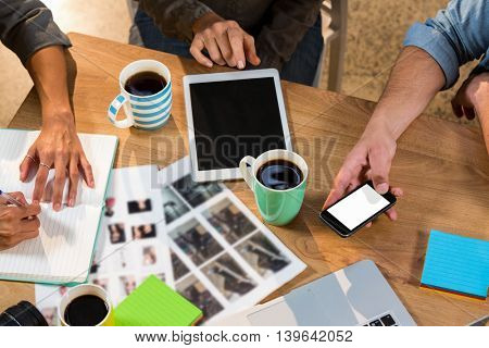 High angle view of creative business people working at table in office