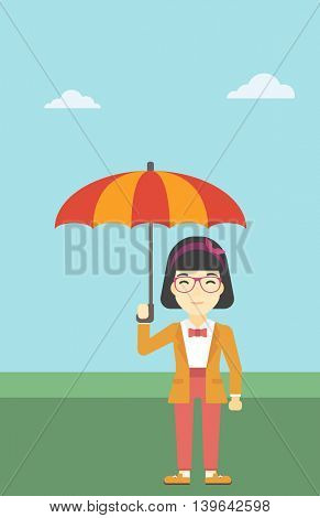 An asian business woman standing with open umbrella on the background of blue sky. A woman under open umbrella. Happy woman with umbrella. Vector flat design illustration. Vertical layout.