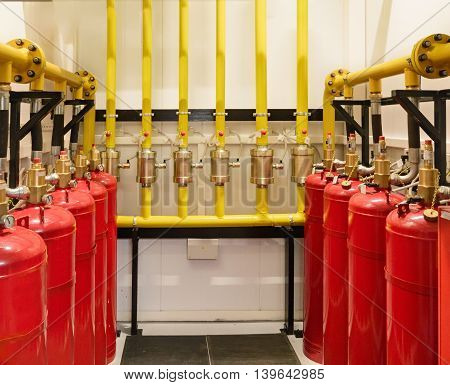 Cylinders and pipe fittings of industrial extinguishing system.