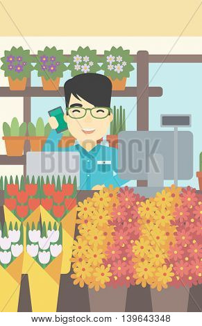 An asian florist using telephone and laptop to take orders. An excited florist standing behind the counter at flower shop. Vector flat design illustration. Vertical layout.