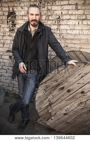 Young Asian Man Over Gray Grungy Background