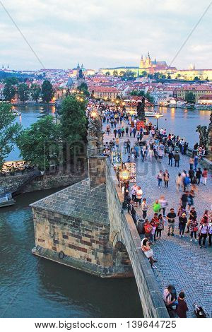 PRAGUE, CZECH REPUBLIC - JUNE 04 2016: Charles Bridge and Hradcany (Prague Castle) with St. Vitus Cathedral and St. George church in the evening Bohemia Prague Czech Republic.
