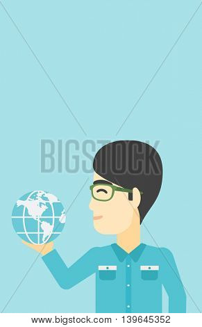 An asian  young businessman holding Earth globe in hand. Concept of global business. Vector flat design illustration. Vertical layout.