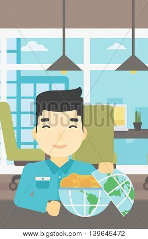 An asian  young businessman sitting at the table in office with a Earth globe full of gold coins. Concept of global business. Vector flat design illustration. Vertical layout.