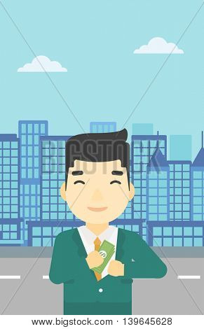 An asian  young businessman putting money in his pocket on a city background. Vector flat design illustration. Vertical layout.